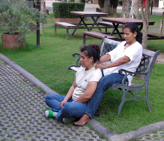 Thai massage therapist relaxes her colleague