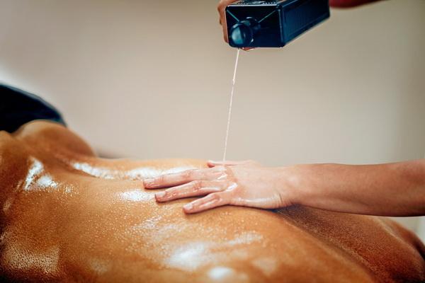 pouring massage oil