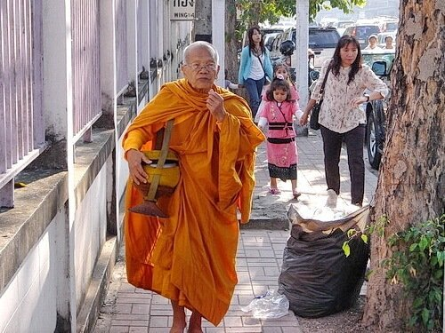 Thai monk with begging bowl
