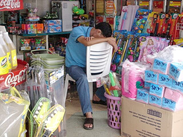 vendor napping in his shop