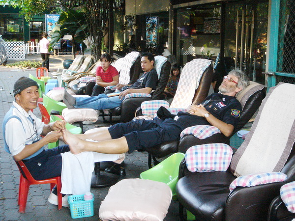Tourist Police Enjoying Foot Massage