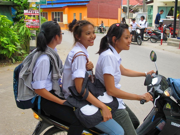 3 girls on scooter