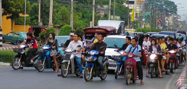 helmetless motorbike riders