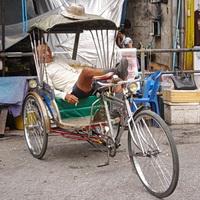 rickshaw driver in thailand