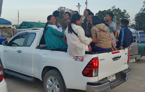 Villagers in pick up truck in northern Thailand